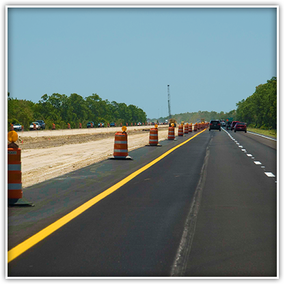 Orange barrels mean pay attention! Please drive carefully in the work zone.