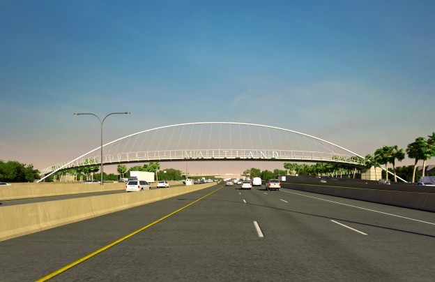 The Maitland interchange project includes a gracefully curving pedestrian bridge with a welcoming sign.